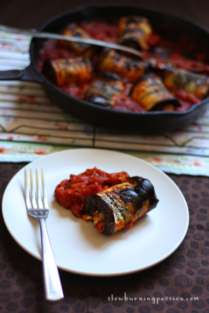 Eggplant Involtini is an Italian vegetarian classic. Roasted slabs of eggplant are rolled around a filling of cheese, toasted pine nuts, and raisins and baked in an Italian red gravy. This version is flavored with orange zest and smoked Spanish paprika. It's to die for. This photo shows a single plated involtini, but you'll surely want at least two!