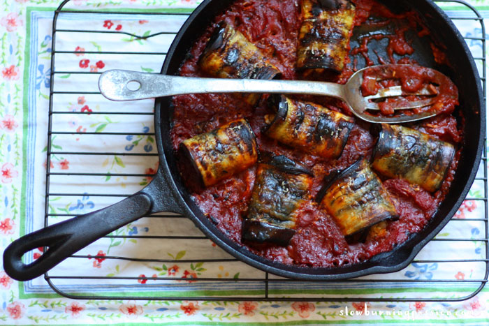 Eggplant Involtini is an Italian vegetarian classic. Roasted slabs of eggplant are rolled around a filling of cheese, toasted pine nuts, and raisins and baked in an Italian red gravy. This version is flavored with orange zest and smoked Spanish paprika. It's to die for.