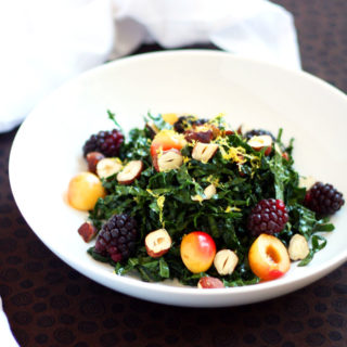 This raw kale salad uses chiffonade of Tuscan kale, extra virgin olive oil, fresh lemon juice, and kosher salt. It's topped with fresh Rainier cherries, loganberries, and crunchy, toasted Oregon hazelnuts.