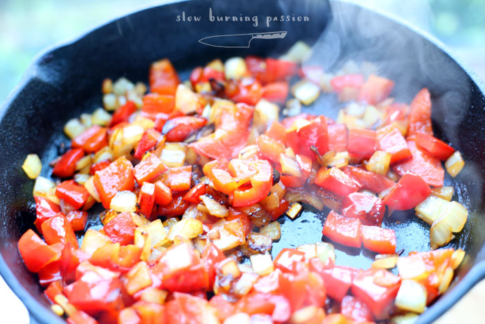 Frying onions and peppers for ojja.